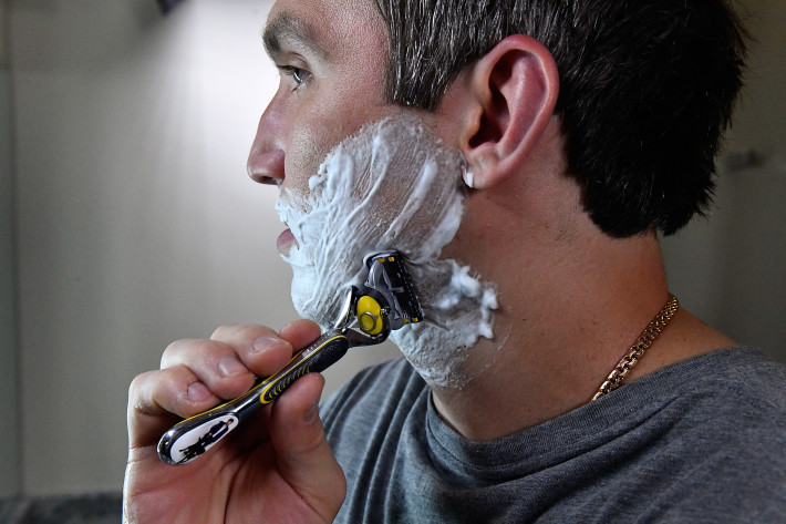 "MCLEAN, VA - JUNE 13: World Champion hockey star Alex Ovechkin shaves his ""playoff beard"" with the Gillette Fusion ProShield Razor during an official Gillette Shave event on June 13, 2018 in Mclean, Virginia. (Photo by Larry French/Getty Images for Gillette)"