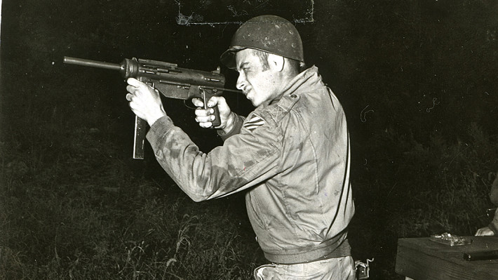 28 October 1953 - Pvt Robert Meyers fires the grease gun during the Armored Stakes course, held at Heavy Tank Co, 7th Inf Regt, 2nd US Inf Div.
